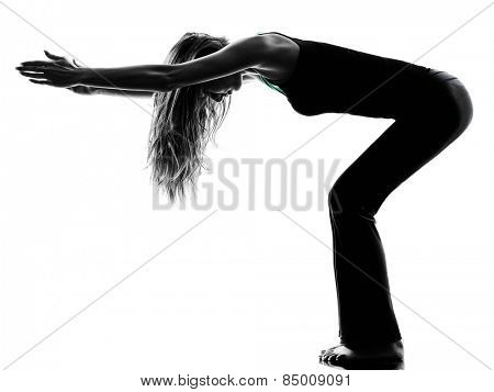 one woman dancer stretching warming up exercises in studio silhouette isolated on white background