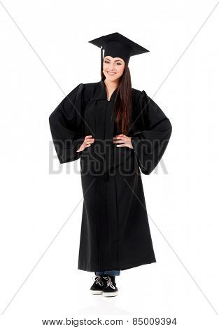 Beautiful graduate girl student in mantle, isolated on white background