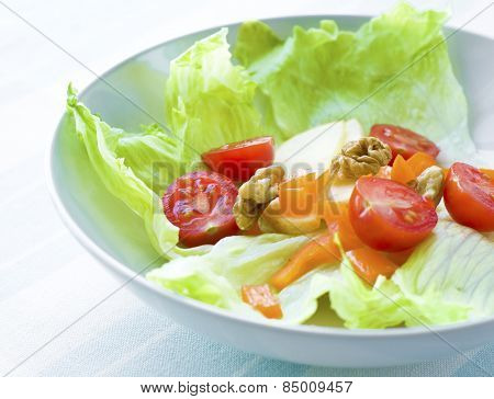 Healthy mixed green salad with nuts.