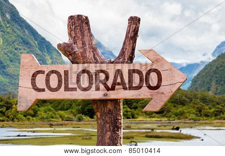 Colorado wooden sign with landscape background
