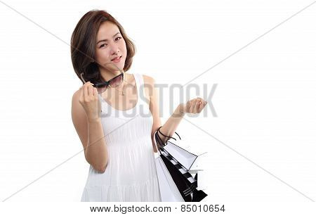 Shopping women asian happy smiling holding shopping bags isolated on white background. Lovely fresh