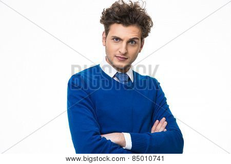 Funny young man with arms folded over white background