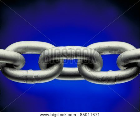Chain detail isolated on blue background.