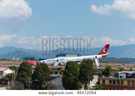 KATHMANDU, NEPAL - MARCH 4, 2015: Turkish Airlines flight THY726 crashed earlier in the morning at Tribhuvan International Airport apparently due to dense fog. No passengers were seriously hurt.