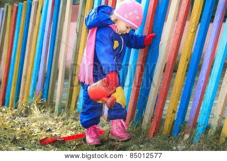 Two Years Old Girl Watering Land In Garden