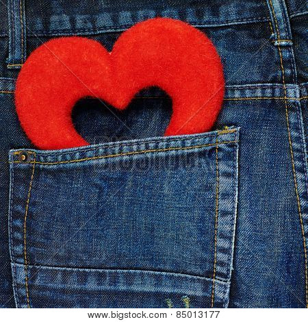 Red heart in a back pocket of a jeans