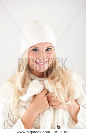 beautiful winter woman in white knit hat and scarf over white background