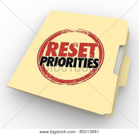 Reset Priorities words stamped on a manila folder to illustrate a change in the most important jobs or tasks to handle first in order