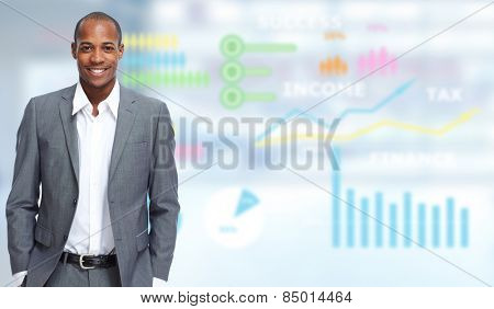 Young executive businessman over office background.