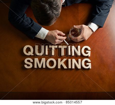 Phrase Quitting Smoking and devastated man composition