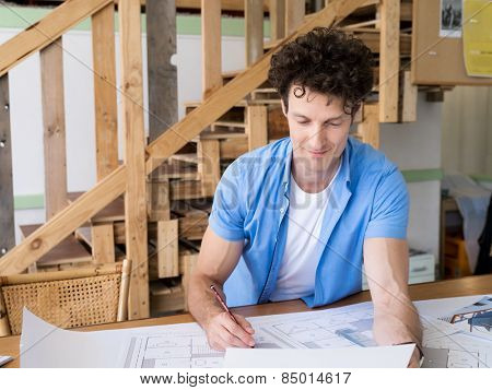 Man working with drafts in office