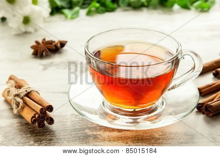 Glass Cup Of Tea On A Wooden Table.