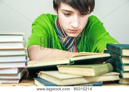 young man reading a book, the student