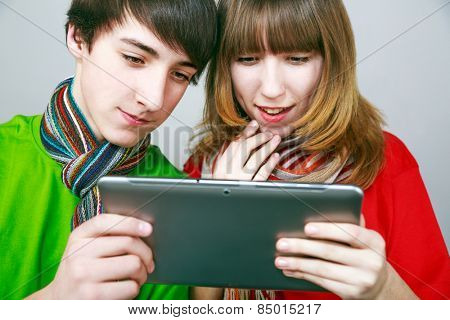 Boy and girl enjoying new tablet.