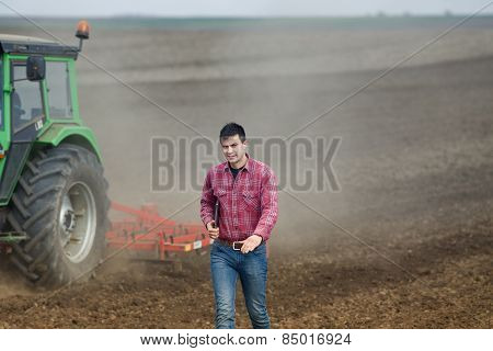 Farmer With Laptop And Tractor