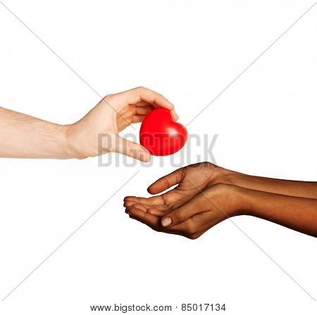 love, charity, valentines day, donation and international concept - close up of man hand giving heart to woman