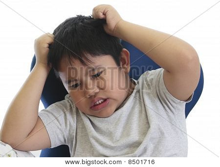 Worried Boy Scratching His Head