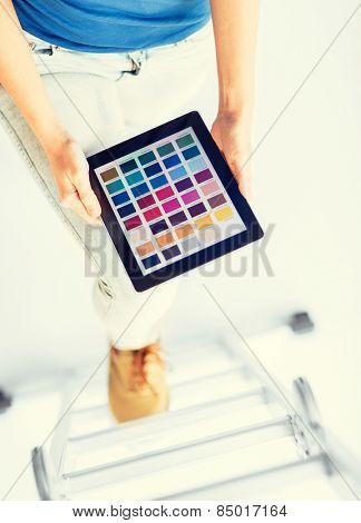 interior design, renovation and technology concept - woman working with color samples on tablet pc