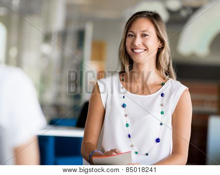 Young woman having an interview in office