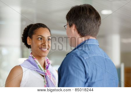 Young businessman and businesswoman shaking hands
