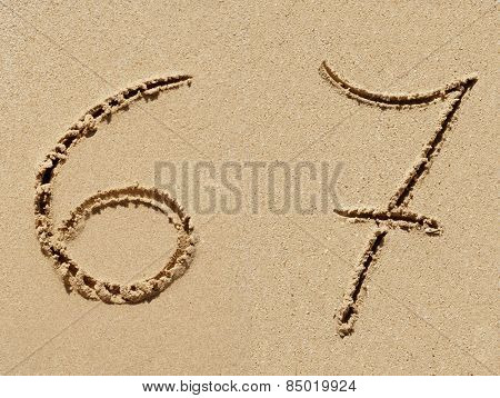 Concept or conceptual sand font or number carved on exotic beach near sea isolated on a sandy background, metaphor to nature, natural, education, character, tropical, tropical, type, message or summer