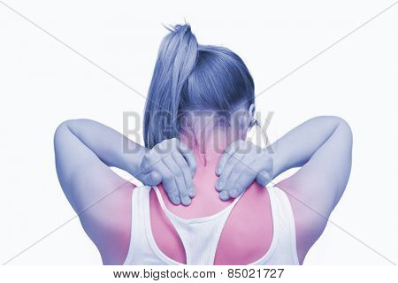 Woman massaging her nape with her hands against white background