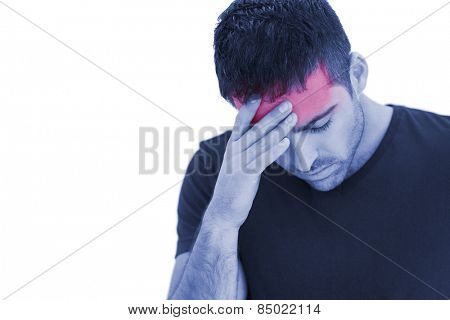 Upset man standing with his hand holding his forehead on white background