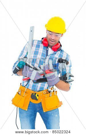 Manual worker balancing various tools on white background