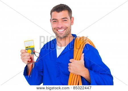 Portrait of smiling electrician with rolled wire and multimeter on white background