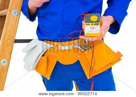Electrician holding multimeter on white background