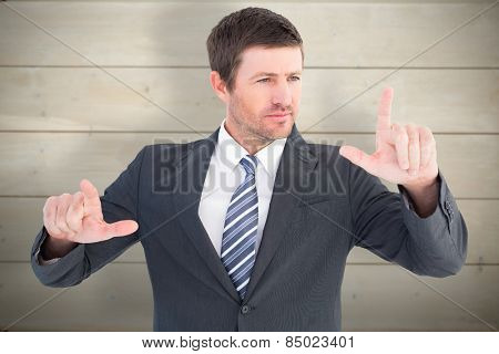 Businessman pointing with his fingers against bleached wooden planks background