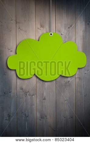 Hanging cloud tag against bleached wooden planks background