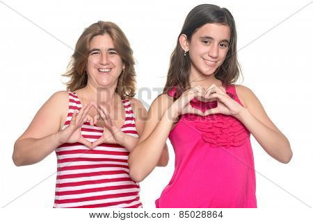 Teenage girl and her young mother doing the heart sign with their hands isolated on white