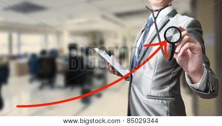 Business Man With Stethoscope Examining Red Curve, Busines Analysis