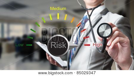Business man with stethoscope examining red curve busines analysis