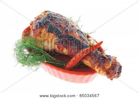 roasted chicken drumstick on red bowl over white