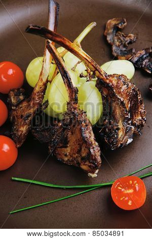 roasted ribs on dish over wooden table