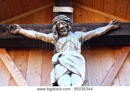 ST. GILGEN, AUSTRIA - DECEMBER 14: Crucifixion, Cemetery in St. Gilgen on Wolfgang See lake, Austria on December 14, 2014.