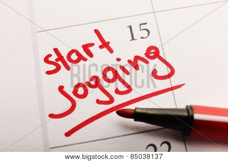 Written plan Start Jogging on calendar page background