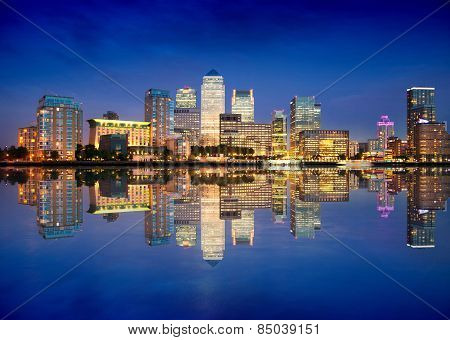 London, Canary Wharf business and banking district night lights