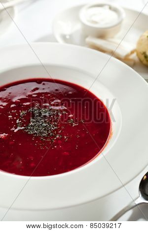 Beetroot and Cabbage Soup with Meat Slice. Garnished with Bread, Lard and Sour Cream
