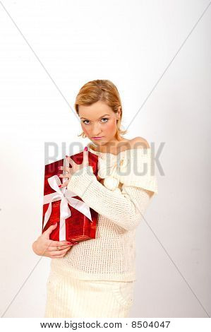 beautiful woman with big red christmas present