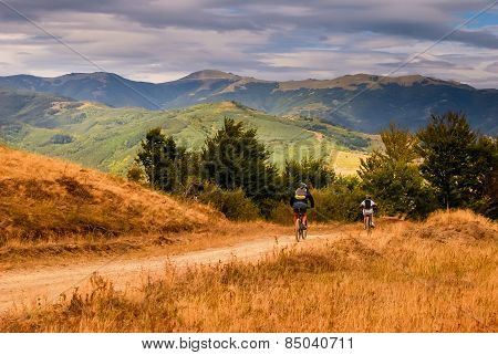Father And Son With Mountain Bikes.