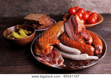 Assortment of deli meats on wooden background