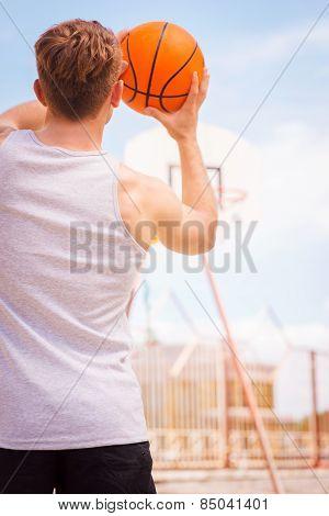 Playing Basketball.