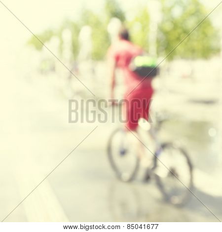 Abstract blurred image of man on bicycle in the city.
