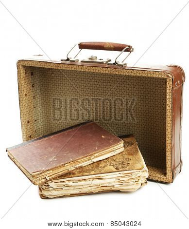 Old wooden suitcase with old books isolated on white