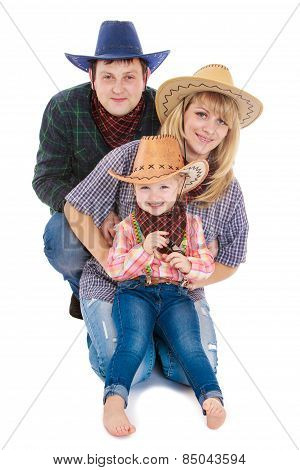 Young family of three persons in the stylish American cowboy cos