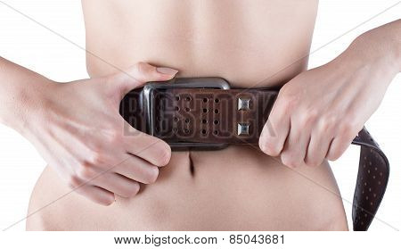 Health And Beauty - Woman Showing Slimming, Tighten Belt, Measuring Her Waistline. Slim Body.