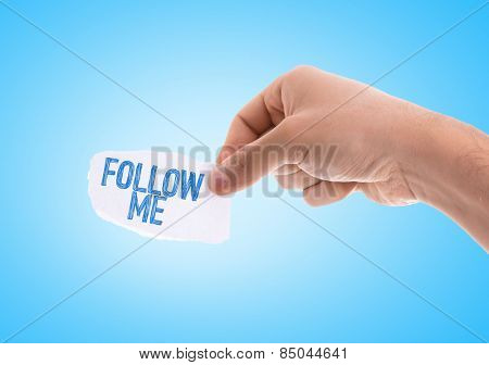 Follow Me piece of paper with blue background